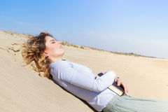 Beautiful student girl resting on the beach Stock Image