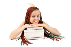 Beautiful student girl resting on stack of books Stock Images