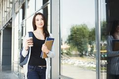 Beautiful student girl with textbooks and coffee Royalty Free Stock Photography