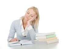 Beautiful student girl tired from doing homework Royalty Free Stock Photo