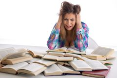 Beautiful student going crazy while studying royalty free stock photography