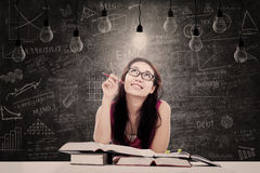 Beautiful student has bright idea Royalty Free Stock Photography