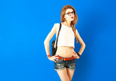 Beautiful Student Hipster Girl on Blue Background Stock Photo