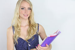 Beautiful student holding books Stock Images