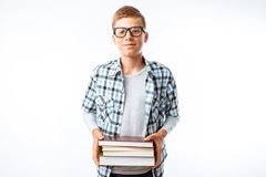 Beautiful student holding a stack of books, a botanist goes with books to study in the Studio on a white background stock image