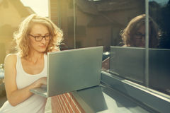 Beautiful student with laptop relaxing outside library Royalty Free Stock Image