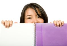 Beautiful student looking over notebook Stock Image