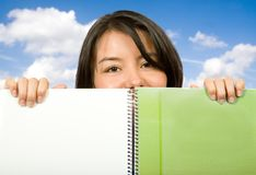 Beautiful student looking over notebook Stock Photo
