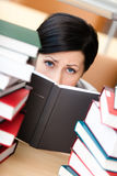 Beautiful student looks out over the book Stock Photo