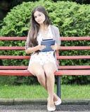 Beautiful student outdoors stock photo