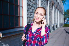 Beautiful student or school girl talking on mobile phone Stock Images
