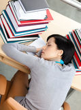 Beautiful student sleeping at the desk Stock Photo