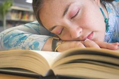 Beautiful student sleeping on the library Royalty Free Stock Images