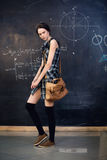 Beautiful student stands at the blackboard. Beautiful tsudentka solves the problem at the blackboard at university Stock Photo