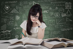 Beautiful student studying in the class Royalty Free Stock Photography