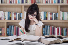 Beautiful student studying in the library Stock Photos