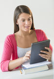 Beautiful Student Using Tablet In Classroom Stock Photo