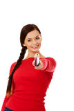 Beautiful student woman pointing up with a big pencil Royalty Free Stock Images