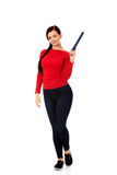 Beautiful student woman pointing up with a big pencil Royalty Free Stock Photo