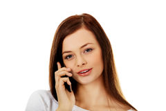 Beautiful student woman talking through a  mobile phone Royalty Free Stock Images