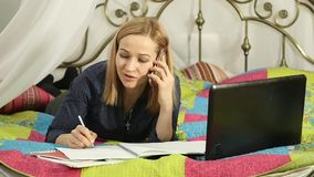 Beautiful student working on her laptop. on-line education in home. slow motion. Beautiful student working on her laptop. on-line education in home stock footage