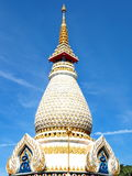 Beautiful stupa soaring into blue sky Royalty Free Stock Photography