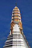 Beautiful stupa soars into blue sky. Beautiful white and golden chedi soars into blue sky at Thai temple Wat Pa Re Rai in Nonthaburi province of Thailand Stock Photos