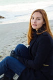 Beautiful and style redhead young woman on seaside.  royalty free stock photography