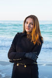 Beautiful and style redhead young woman on seaside.  royalty free stock images