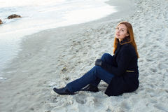 Beautiful and style redhead young woman on seaside Royalty Free Stock Image