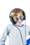 Beautiful stylish blond child wearing big professional headphones and funny glasses Royalty Free Stock Images