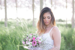 Beautiful stylish bride in a wedding dress . Beautiful attractive young bride in a wedding dress in a spring forest stock photo