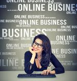 Content woman conducting online business stock photography