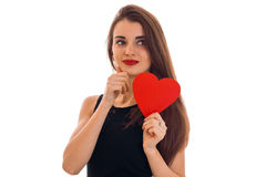 Beautiful stylish brunette lady celebrate saint valentines day with red heart isolated on white background Stock Images