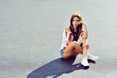 Beautiful stylish brunette woman outdoor portrait.  Stock Photography
