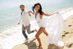Beautiful stylish couple just married, have escape in Greece in summer time, perfect sunny day. stock photo