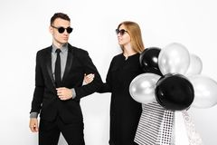 Beautiful stylish couple, young girl in a black dress and a man stock image