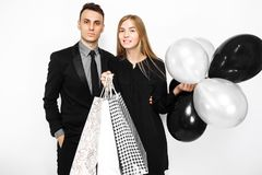 Beautiful stylish couple, young girl in a black dress and a man stock photos