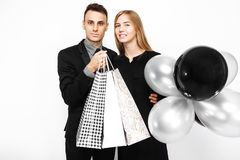 Beautiful stylish couple, young girl in a black dress and a man stock images