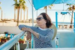Beautiful stylish elderly woman travels on a yacht, on a backgro Royalty Free Stock Image