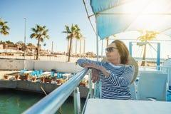 Beautiful stylish elderly woman travels on a yacht, on a backgro Stock Photography