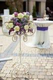 Beautiful stylish flower stand at wedding aisle closeup Stock Photo