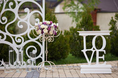 Beautiful stylish flower stand at wedding aisle closeup Stock Photos