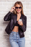 Beautiful stylish girl with gadget Royalty Free Stock Photography