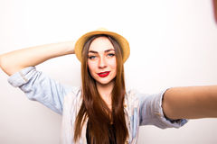 Beautiful stylish girl in hat making selfie Stock Images