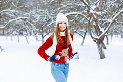 Beautiful stylish girl in a knitted cap, red sweater with a deer Stock Image