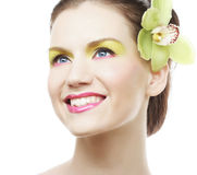 Beautiful stylish girl with orchid flower in hair. Stock Image