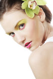 Beautiful stylish girl with orchid flower in hair. Royalty Free Stock Photo