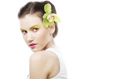 Beautiful stylish girl with orchid flower in hair. Stock Photos