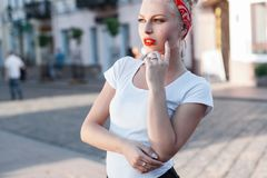 Beautiful stylish girl. Shopping centers and people in the backg Royalty Free Stock Photos